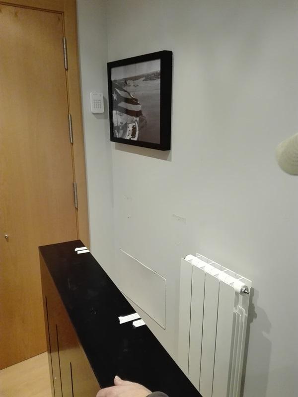 Instalando cubrerradiador a medida lacado negro y cuadros for Cuadros a medida