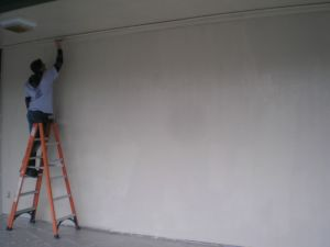 A volunteer paints during the 2011 ServeINC project.