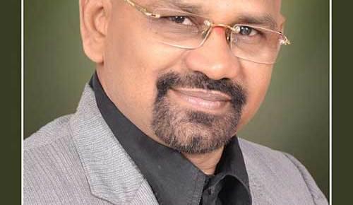 professor ms rao india headshot business attire green background