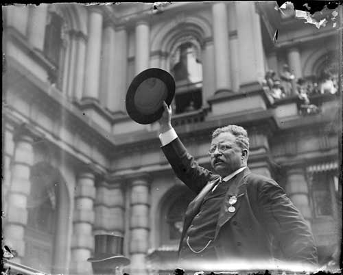 Theodore Roosevelt waving hat Boston 1912 at www.servetolead.org