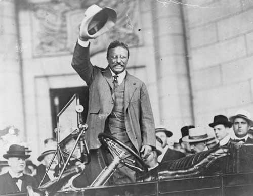 Theodore Roosevelt smiling waving hat www.servetolead.org