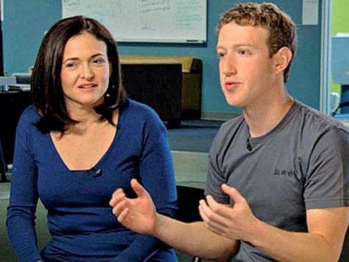 Sheryl Sandberg and Mark Zuckerberg talking on http://servetoleadgrp.wpengine.com