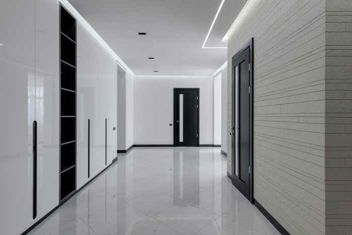 big hall in minimalistic style in modern apartment building