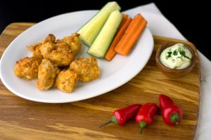 vegan cauliflower wings with peppers and vegan ranch