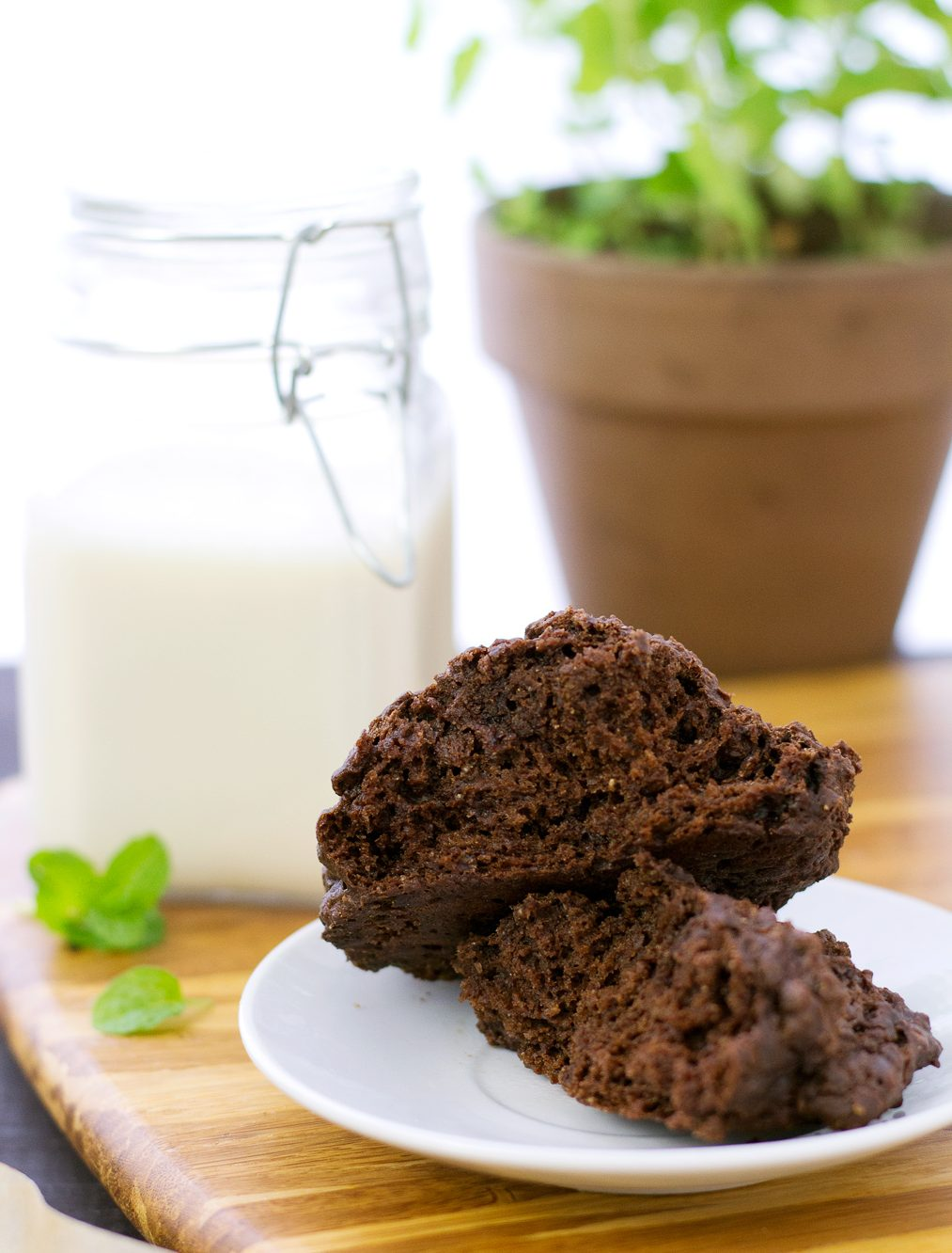 Easy vegan chocolate mint scone broken open to show a delicious and moist inside!