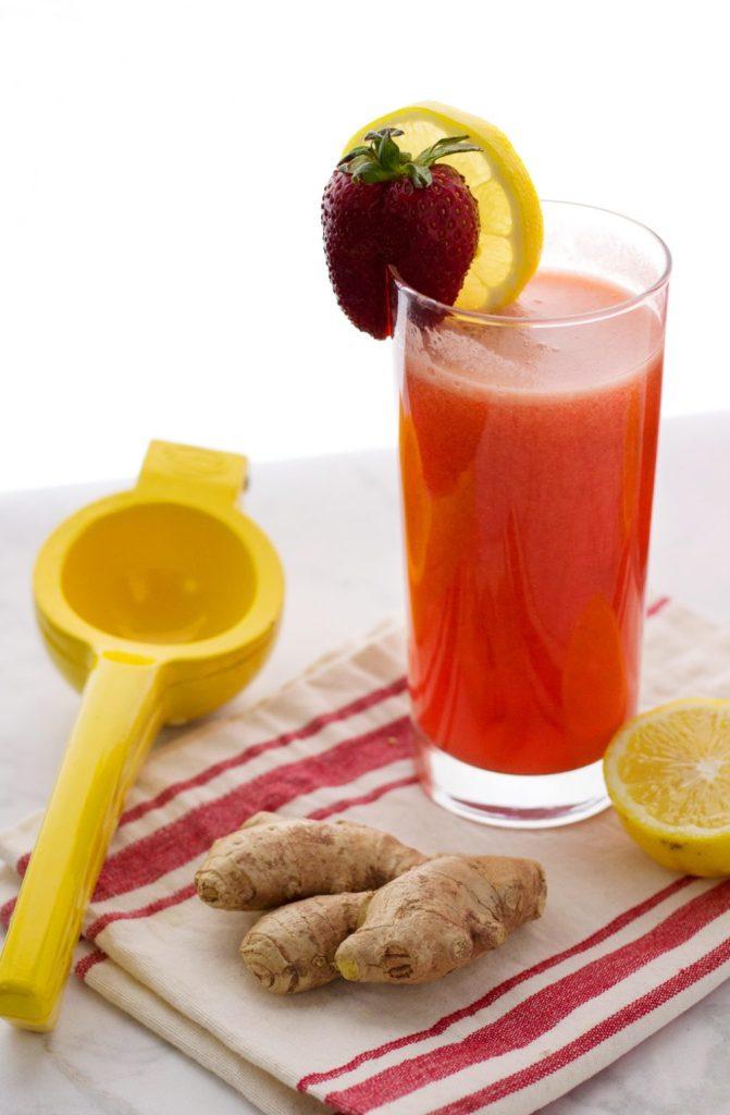 Tall glass of easy vegan strawberry ginger lemonade recipe