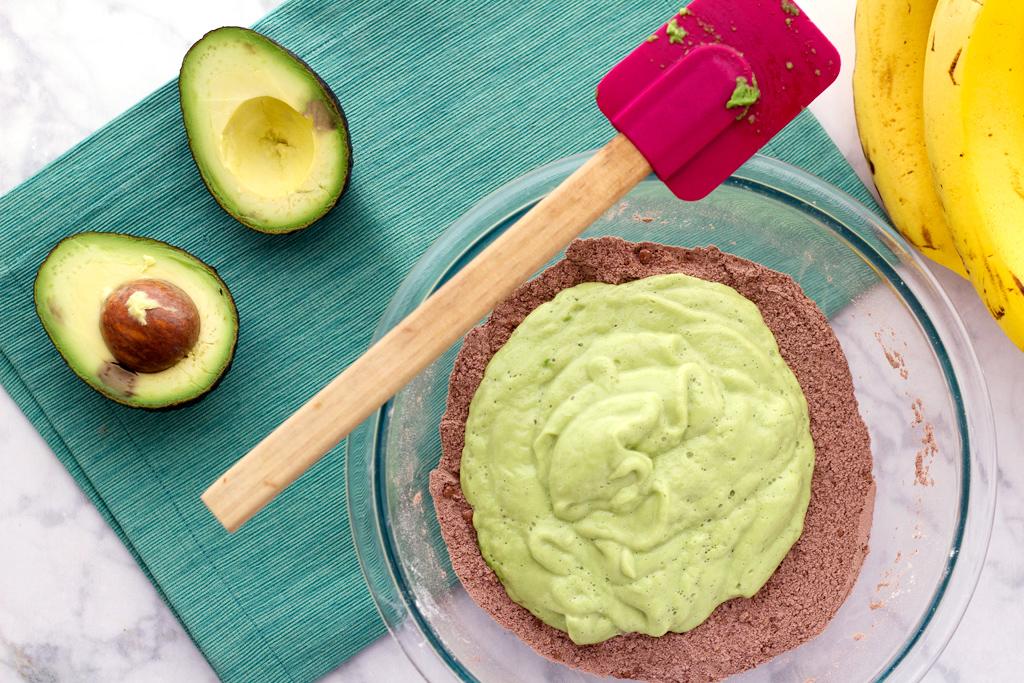 Mixing easy vegan avocado brownie batter