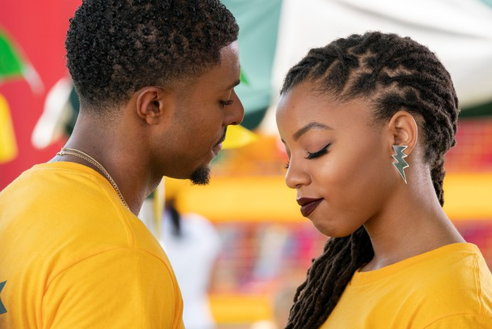 Diggy Simmons and Chloe Bailey facing each other wearing yellow t-shirts on the set of Grown-ish
