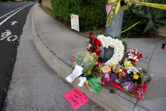 A makeshift memorial was placed by a light pole a block away from a shooting incident where one person was killed at the Congregation Chabad synagogue in Poway, north of San Diego, California,  Apr. 27, 2019.