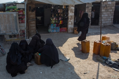 Many women in the camp are hostile to foreign journalists and security guards, while others fear the extremists' wrath on Oct. 1