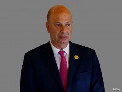 Gordon Sondland headshot, as US Ambassador to the European Union, graphic element on gray