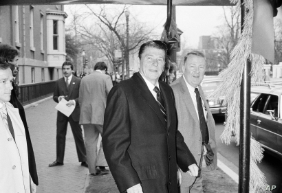 President elect Ronald Reagan and his transition team leader Edwin Meese leave the Blair House in Washington December 10, 1980,…