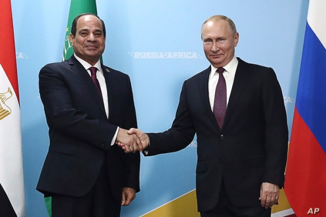 FILE - Russian President Vladimir Putin, right, and Egypt's President Abdel Fattah el-Sissi pose for a photo prior to talks in the Black Sea resort of Sochi, Russia, Oct. 23, 2019.