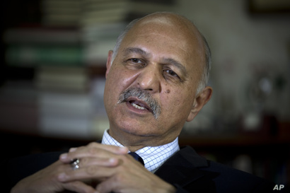 In this Nov. 30, 2018 photo, Mushahid Hussain, chairman of Pakistan's Senate Foreign Affairs Committee, speaks to The…