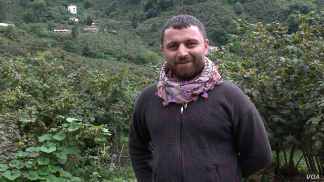 Iskender started picking hazelnuts when he was 15 years old, now 30 he runs a team of pickers, but regrets having to leave his home in Turkey's predominantly Kurdish region to work in the hazelnut fields. (D.Jones.VOA)
