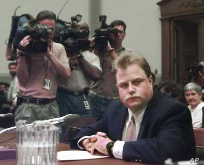 Photographers surround Richard Jewell prior to his testifying before a House Judiciary Crime subcommittee hearing on the last…
