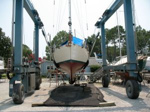 Looking at Sirocco head-on while she hangs in the slings.  Her fine underwater lines are apparent from this angle.  The very bottom of her keel is narrower than that of the Contessa 26, which contributes to her relative efficiency.