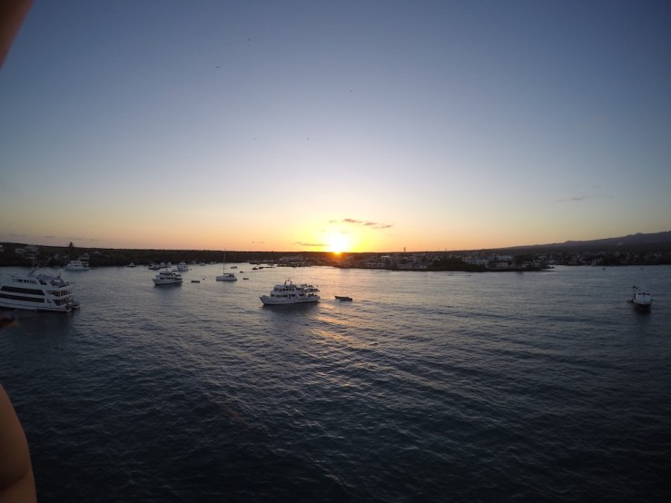 A sunset over Puerto Ayora as seen from the masthead of Starlight.