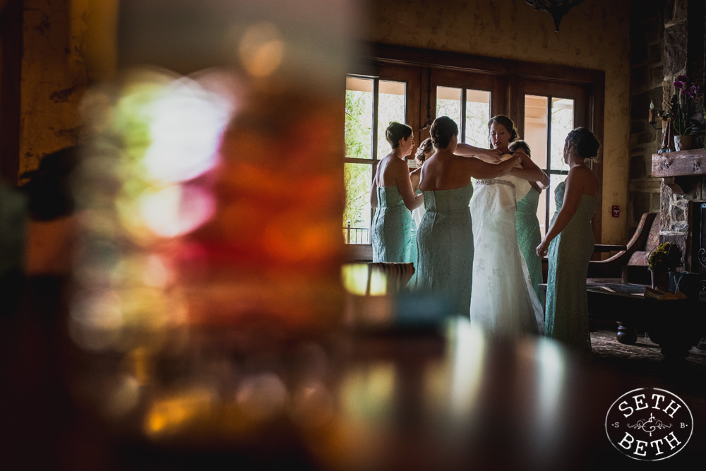 Bride getting in her gown at a Gervasi Vineyard Wedding