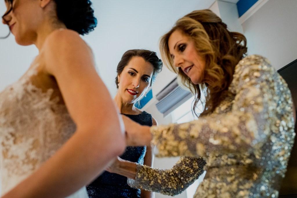 Bride getting into her dress at Columbus Ohio Westin Wedding
