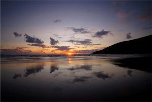 Saunton beach at sunset with the waves coming in