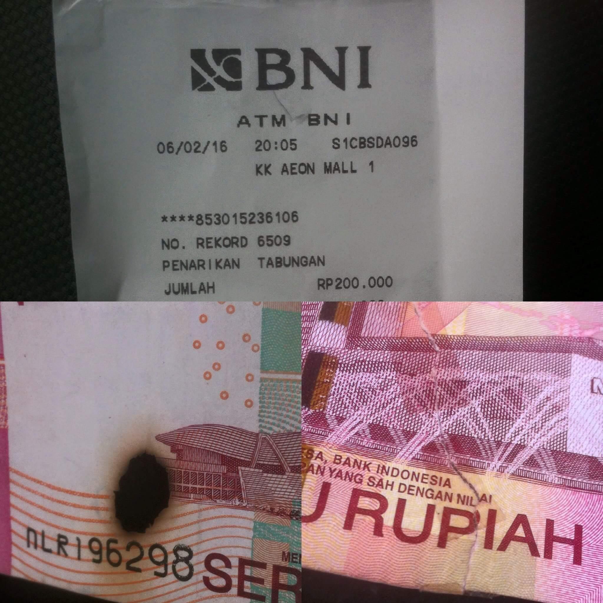 uang dari ATM kok rusak dan isoalian yah