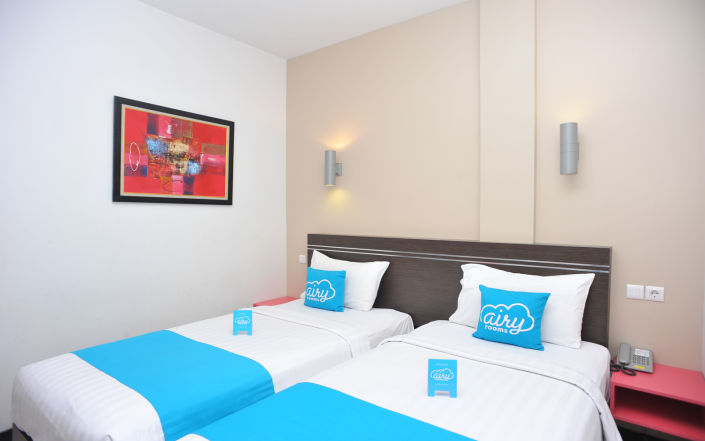 kamar hotel airy rooms