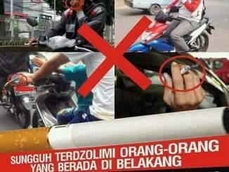 denda orang merokok sambil berkendara naik motor