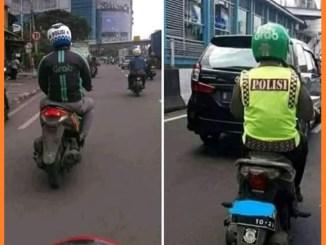 helm yang tertukar antara grab dan polisi