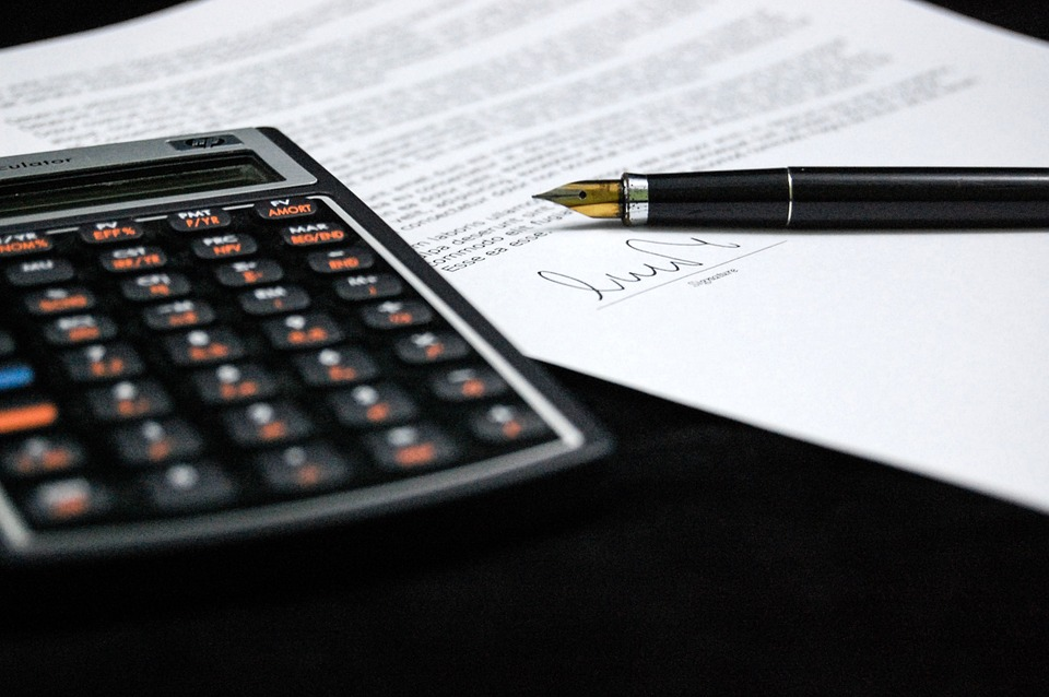 calculator-and-contract-on-desk
