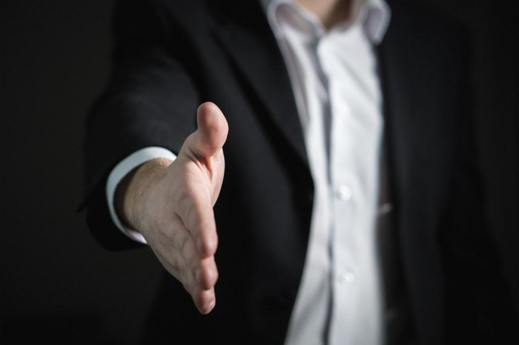 man-extending-handshake