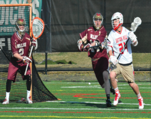 Piche anticipating the wrap-around shot to give the Griffins a point. Photos courtesy of D.Clark/ Setonian