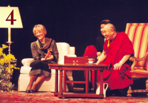 The late Dr. JoAnne Boyle with the Dalai Lama during his speech. Photo courtesy of Seton Hill Archives