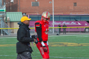 Senior linebacker and captain, Tim Johnson, with head coach Isaac Collins discussing the Griffins game plan. Photo courtesy of D.Clark/Setonian