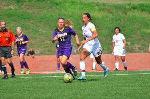 Hanna Marks, senior defender, sprinting past opposing team defenders. Photo courtesy of D. Clark/Setonian