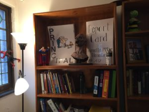 King keeps a shelf in his office of memorabilia from previous teaching jobs. Photo courtesy of Seton Hill and Callista Arida