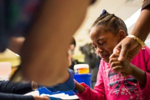 A young girl from Flint undergoes a blood test for lead. Around 8,000 Flint children were exposed to lead in the drinking water, which can cause irreversible brain damage. Photo courtesy of vox.com