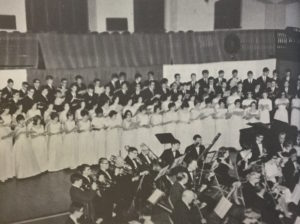 The combined Glee Clubs of Saint Vincent and Seton Hill Colleges perform with the College Community Symphony Orchestra. Photo courtesy of the Seton Hill Archives.
