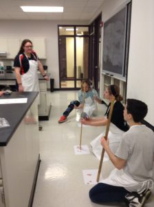 High school students learn how to perform a blood stain analysis. Photo courtesy of J.Walker