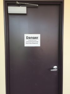"A sign on the third floor of the Boyle Center reads: ""Danger - Construction Area - Authorized Personnel Only - Hard Hats Required."" Workers began working on the third floor in July. Photo courtesy of P.Parise."