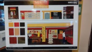 A board at the entrance of the bookstore lays out the future design, featuring familiar Seton Hill logos. The bookstore closed for a few weeks over the summer for renovation, and work will also be done to complete the renovation at the end of September and over fall break. Photo courtesy of H.Carnahan.