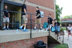 The SHU men's lacrosse team helps freshmen carry their belongings as they move into their dorms for the first time. Photo courtesy of E.Michaux.
