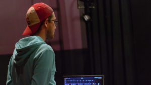 Lighting designer Greg Messmer looks on at a rehearsal. Photo courtesy of B.Malley.