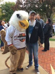 Carmen Capozzi takes a picture with the Griffin. Photo courtesy of H.Carnahan/Setonian.
