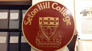 This artifact was moved to the archives when Seton Hill College was renamed Seton Hill University. It is still hanging proudly as a strong memory to the ones who remember. Photo courtesy of L.Cowan/Setonian.