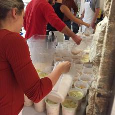 Students in the physician assistant program at Seton Hill fill up containers with soup. Photo courtesy of S.Howell.