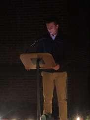 Freshman class treasurer Matthew Alexander presents another reading from the Gospel of Luke.