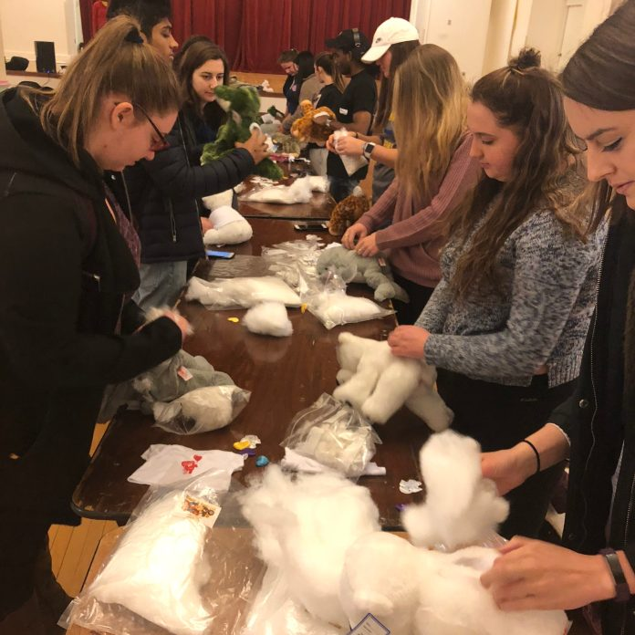 Students add stuffing to their new cuddly friends during Seton Hill's Take a Bear, Send a Bear event on Feb. 8. Photo by C.Arida/Setonian.