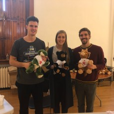 From left to right, junior Patrick O'Connor, junior Randi Selbekk and graduate assistant Marcus Weakland smile with their stuffed animals. Photo by C.Arida/Setonian.