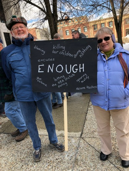 Rev. Wayne Sautter and Ellen Sautter of Latrobe, Pa. hold their sign at the March for Our Lives rally in Greensburg on March 23.